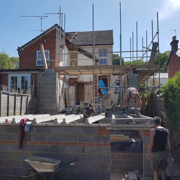 A group of builders working on an extension
